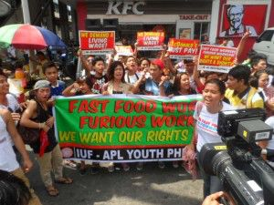 Fast food workers in Manila protest on May 15.
