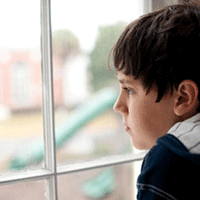 boy looking out school window