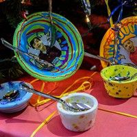 Pittsburgh Gifted Students' ceramic bowls under their Helping Hands holiday tree