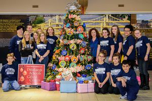 Pittsburgh Gifted Students with their Helping Hands Holiday Tree at the Pittsburgh Airport