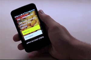 hand holding a smartphone running a food stamp application app