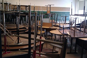 Stacked furniture in closed school | WBEZ/Linda Lutton