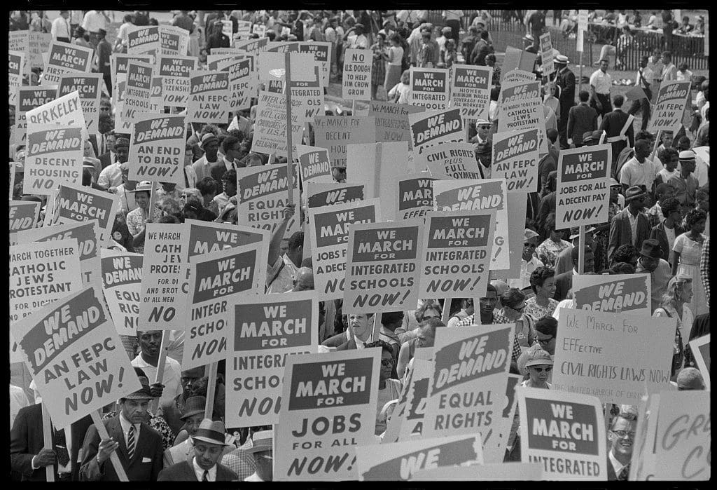 Signs carried by many marchers, during the March on Washington for Jobs and Freedom, 1963 (Wikimedia Commons)