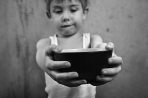 boy holding empty bowl