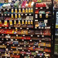 candy display and soda cooler in store