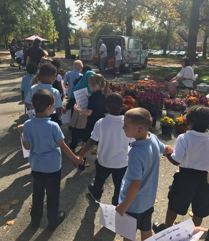 Allegheny Traditional Academy kids hold hands on the way to the North Side farmers market, Sep. 2017