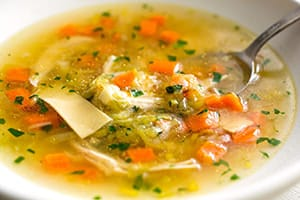chicken noodle soup (via Andrew Scrivani for The New York Times)