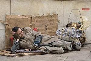 figure redirecting pedestrian's gaze from homeless man