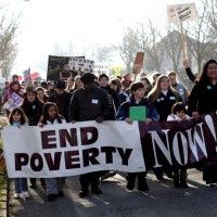 people marching with end poverty now! banner