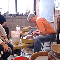 volunteers at Manchester Craftsmans Guild make bowls for Empty Bowls