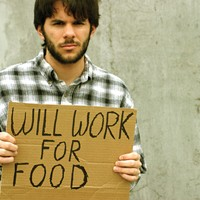 "Man with ""will work for food"" sign"