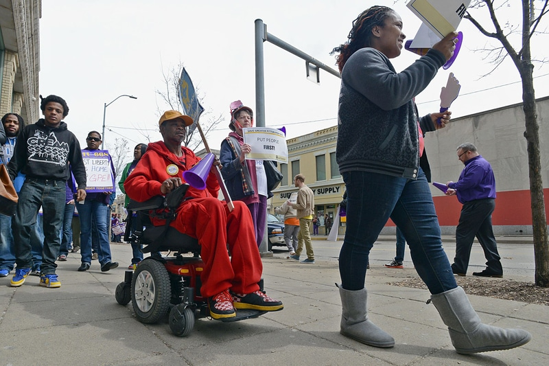 Just Harvest, SEIU, and Action United protest the closing of the East Liberty state Dept of Public Welfare office in East Liberty, 04/01/14   Bob Donaldson, Pittsburgh Post-Gazette