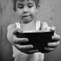 boy holding empty bowl