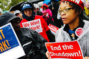 "Government shutdown protesters with signs saying ""We Want to Work!"" and ""End the Shutdown"""