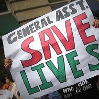Protester holding sign: Geneal Asst. Save Lives