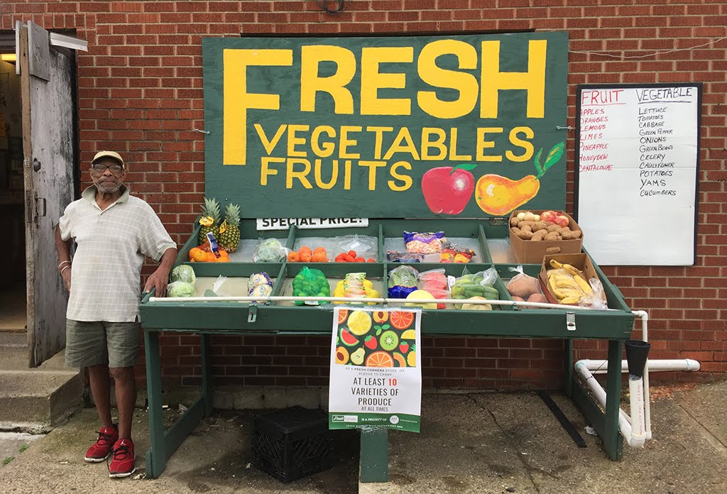 The fresh vegetables and fruits stand outside Ann's Market in the Hill