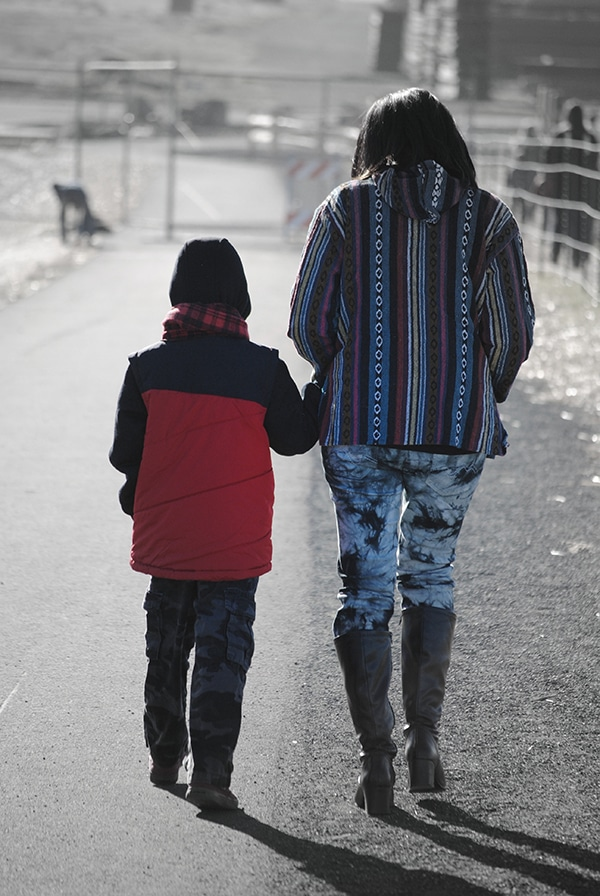 woman walking with her young son