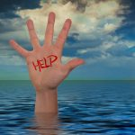 person raising hand out of ocean for help (via pixabay/Gerd Altmann)