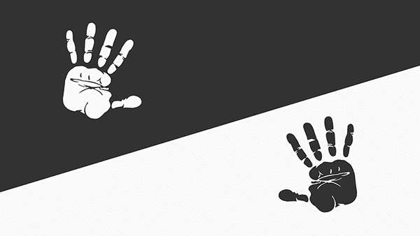 two black and white hands on white and black backgrounds